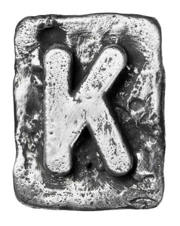 Metal alloy alphabet letter K photo