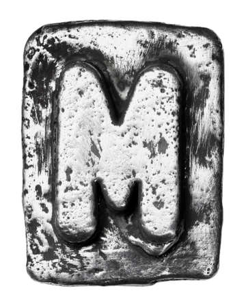 Metal alloy alphabet letter M photo