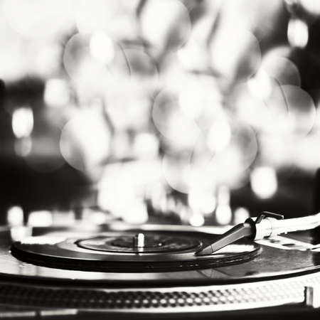playing music: Vinyl record spinning on turntable Stock Photo