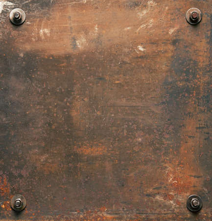 Rusty metal plate texture with bolts. photo