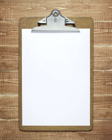 clamps: Clipboard with a blank sheet of paper on wooden table Stock Photo
