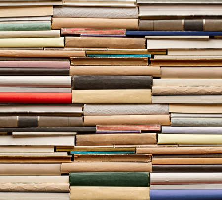 book spine: Stack of old books. No labels, blank spine.