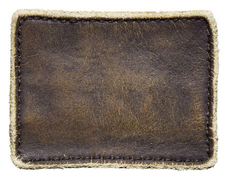 Blank leather jeans label, isolated. photo