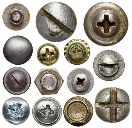 tuercas y tornillos: Cabezas de los tornillos, tuercas, remaches Foto de archivo