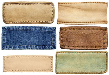 Blank leather jeans labels, isolated. Stock Photo