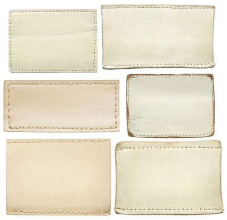leather stitch: White leather jeans labels, leather tags. Stock Photo