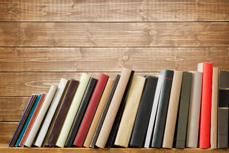 Old books on a wooden shelf. No labels, blank spine. Stock Photo - 20343649