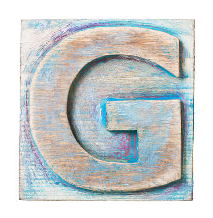 Wooden alphabet block, letter G photo