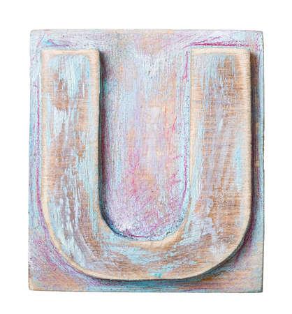 typeset: Wooden alphabet block, letter U