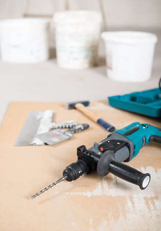 electric drill: Electric drill and other tools, construction site.