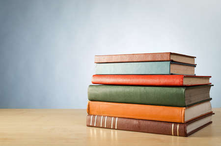 bookshelves: Books on the table. No labels, blank spine. Stock Photo