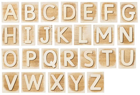 Wooden alphabet blocks isolated on white photo