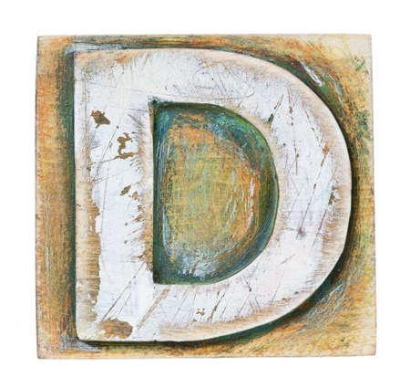 d: Wooden alphabet block, letter D