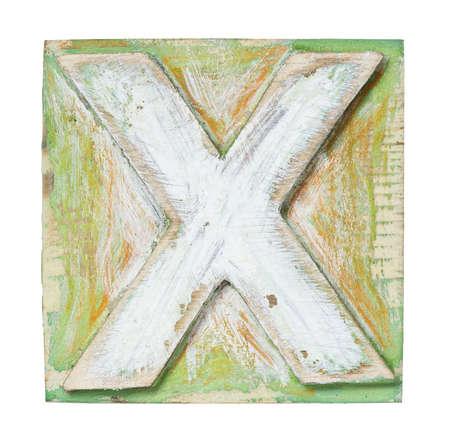 Wooden alphabet block, letter X photo