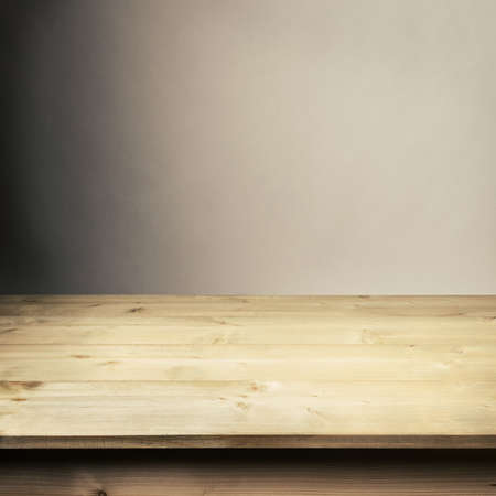 table: Wooden table in front of wall