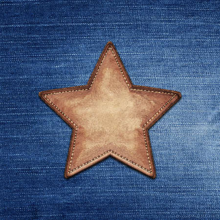 star shape: Star shape leather label on jeans texture Stock Photo