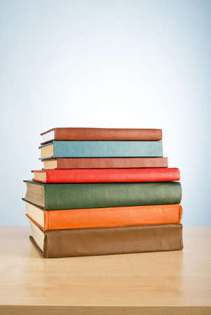 book spine: Books on the table. No labels, blank spine. Stock Photo