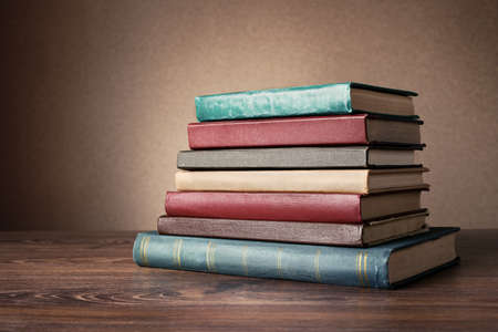 Books on the table. No labels, blank spine. Stock Photo