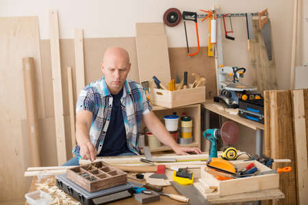 Carpenter at woodwork workshop. Stock Photo - 21705484