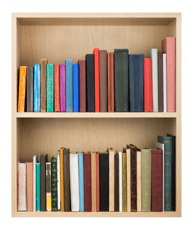 Old books on a wooden shelf.  Stock Photo