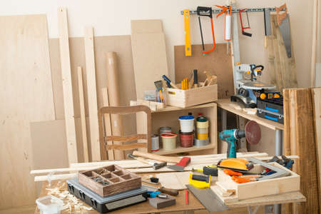 Carpentry workshop with tools and supplies Stock Photo