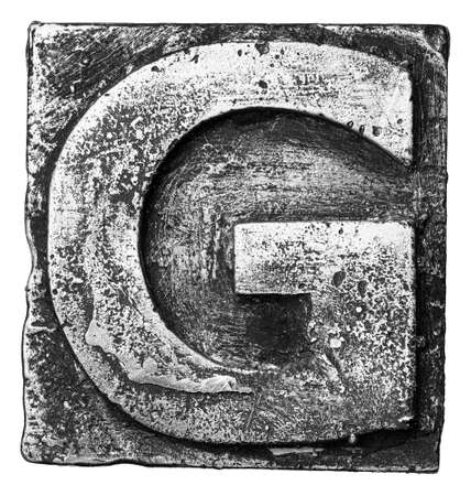 Metal alloy alphabet letter G photo