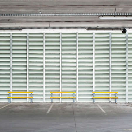 parking lot interior: Empty parking lot wall, floor and ceiling.