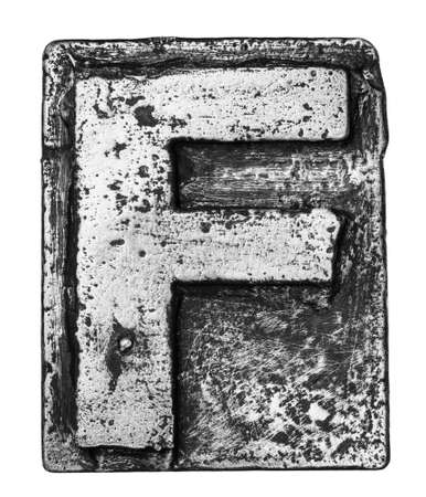 Metal alloy alphabet letter F photo