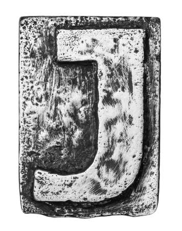 Metal alloy alphabet letter J photo