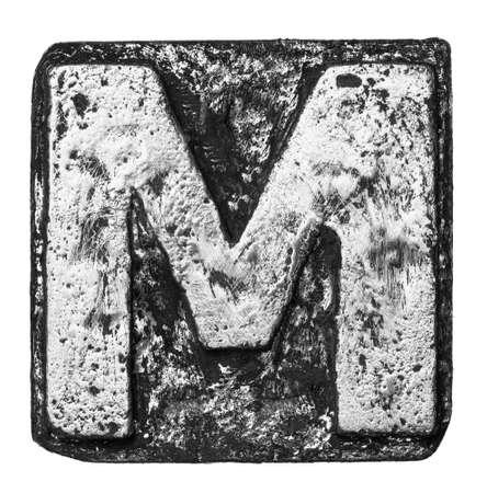 Metal alloy alphabet letter M photo