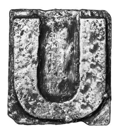 Metal alloy alphabet letter U photo