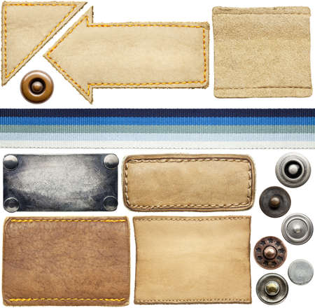 Blank leather jeans labels, buttons, rivets. photo