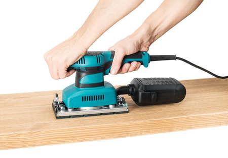 sander: Carpenter working with electrical sander.