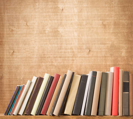 Old books on a wooden shelf. Stock Photo - 23335570
