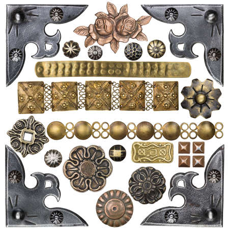 Vintage metal corners, nails, buttons and other design elements photo