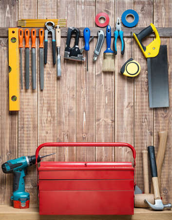 tool box: Carpentry tools hanging on the wall.