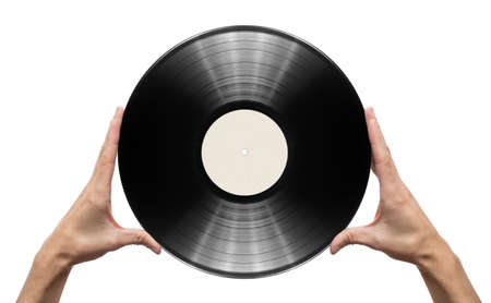 Man's hands holding vinyl record. photo