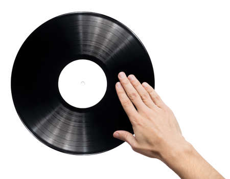 Man's hand scratching vinyl record. photo