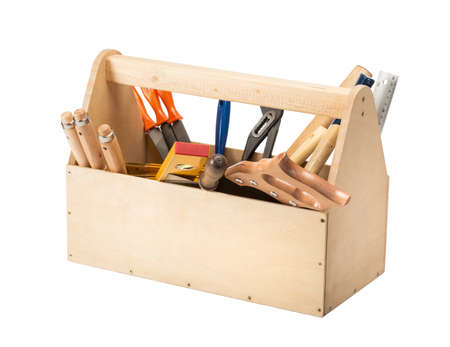 Wooden toolbox with tools isolated on white photo