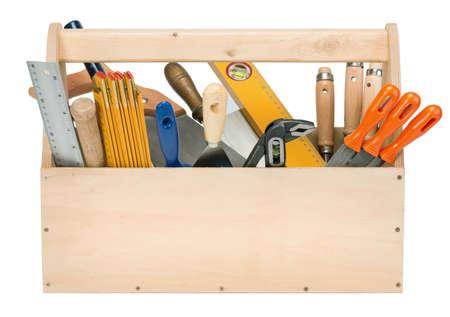 Caja de herramientas de madera con herramientas aisladas en blanco photo
