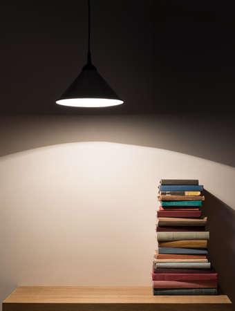 table lamp: Books on the shelf. Stock Photo