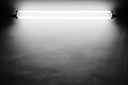 Fluorescent light tube on the wall photo
