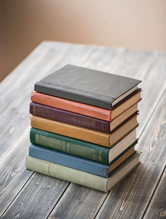 Old books on wooden table photo