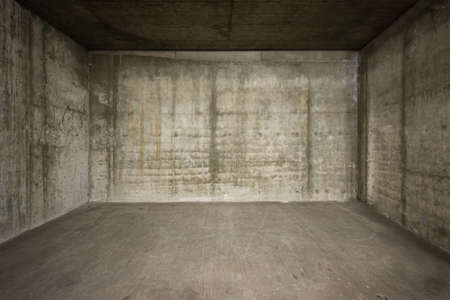 Empty room with concrete walls and floor. photo