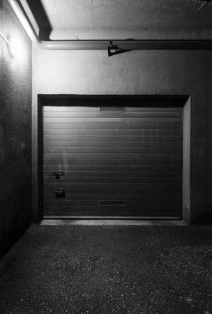 Garage doors at night photo