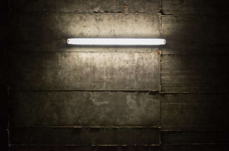 Fluorescent light tube on the wall photo