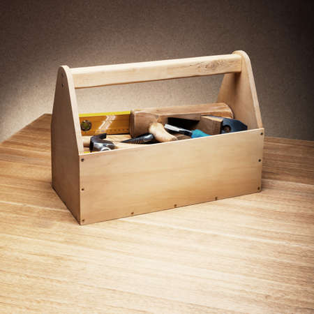 Wooden toolbox on the table photo