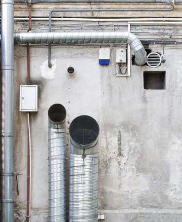 Pipes and wires on the wall  photo