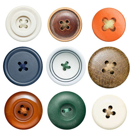 Various sewing buttons with a thread  photo