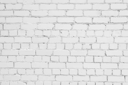 eroded: White brick wall background, texture